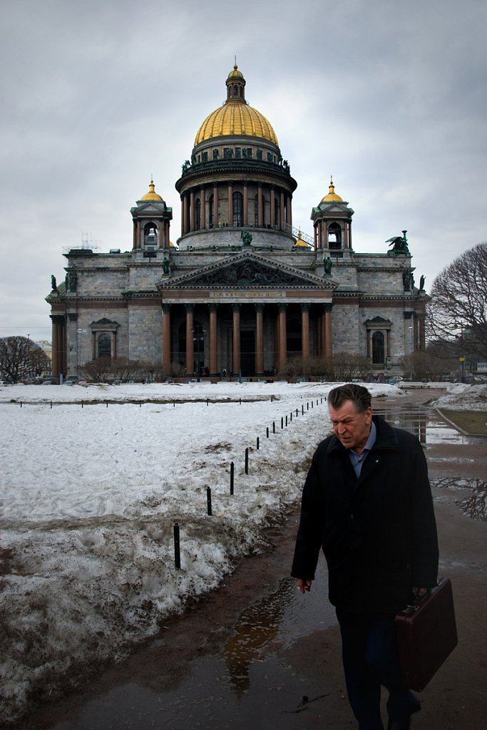 Old man walking from St. Isaak