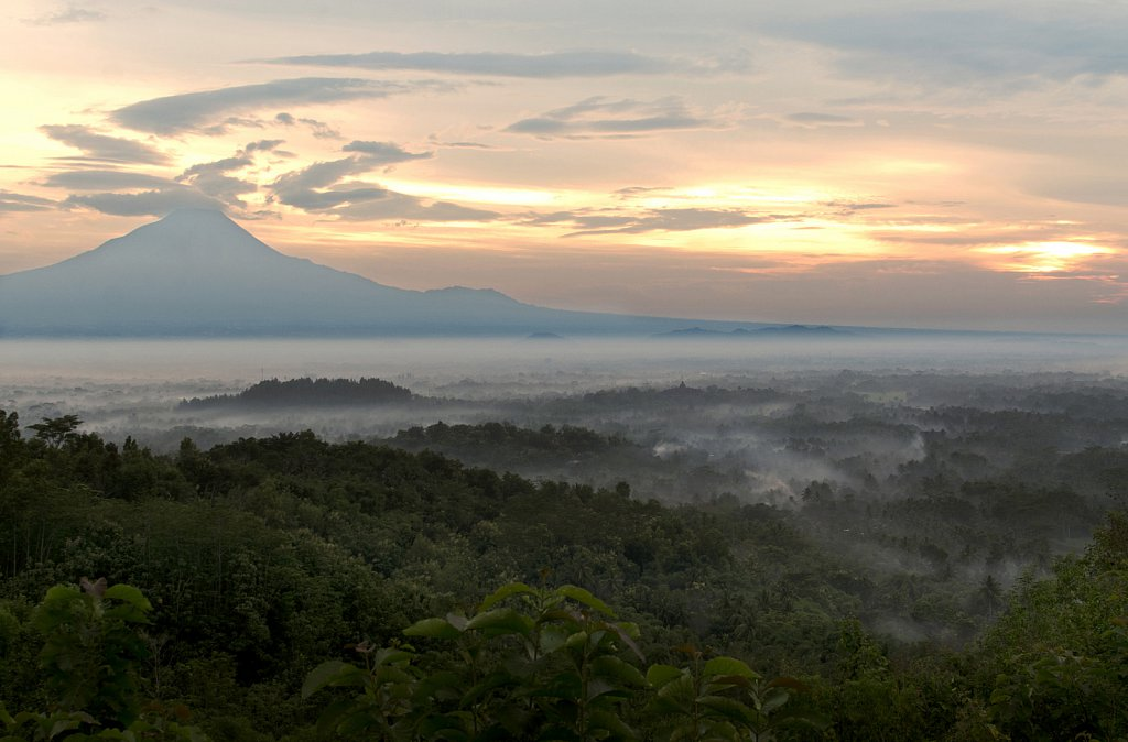Morning mist over Borobodur temple valley