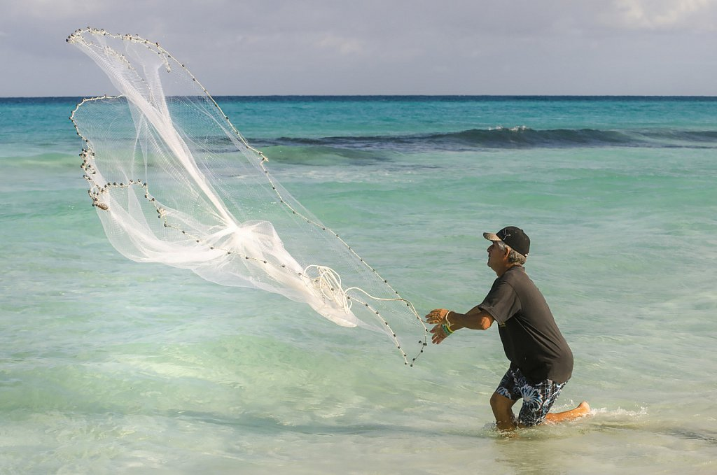 Fisherman throwing net at Varadero beach