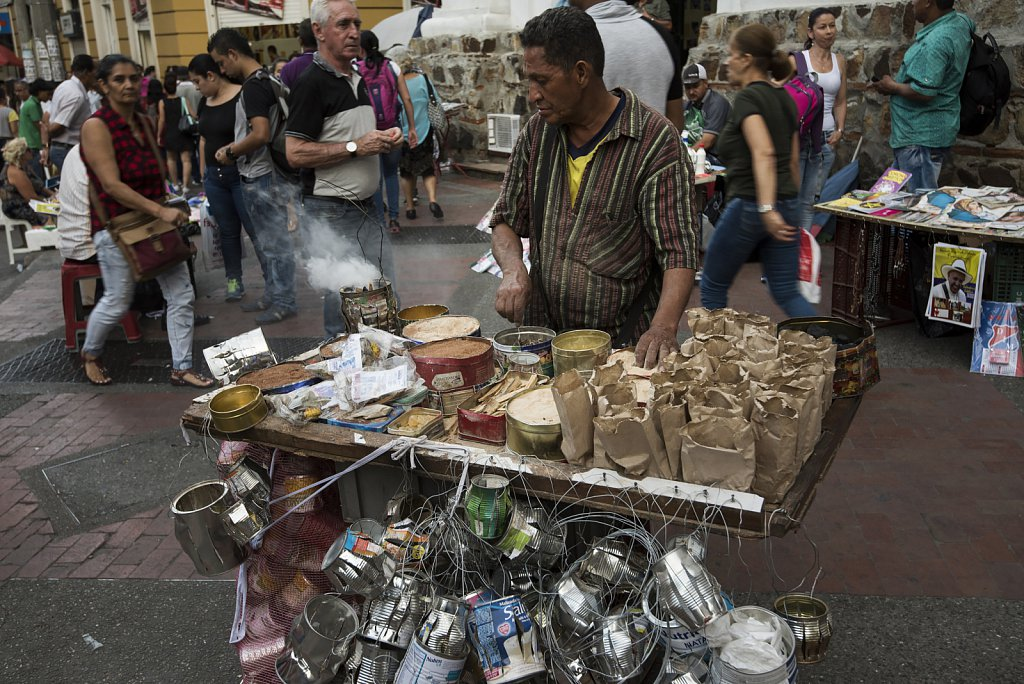 Medellín Downtown - Selling incence in front of church
